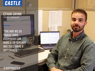 Ethan Gwinn is seated at a computer work station at the Castle Contracting office.